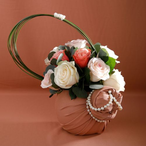 Mix Roses in a Fish Bowl covered with a cloth for all occasions.
