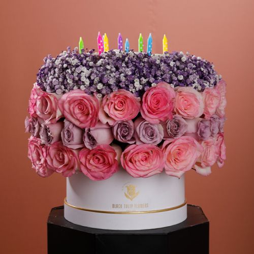 Mix of Pink & Purple Roses with Sprayed Gypsophila in a Cake Shape specially curated for Birthdays.