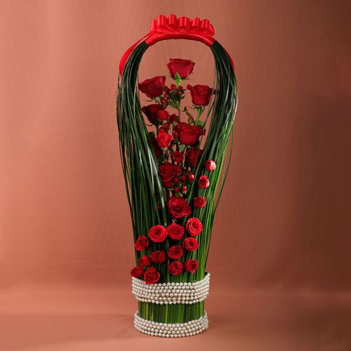 Red Roses with Hypericums and Steel Grass for any occasions.